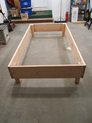 Photo of a rectangular raised bed garden plot assembled out of lumber.