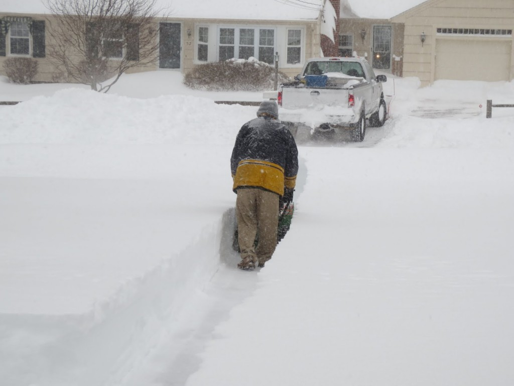 A photograph of Dennis O'Neill clearing his driveway in Holden, Massachusetts after the Blizzard of 2013.