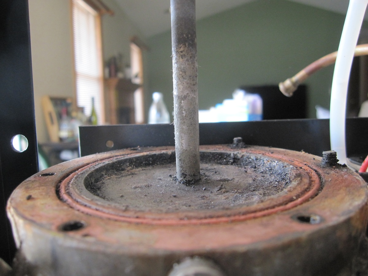 Photograph of an opened boiler from a Rancilio Silvia espresso machine.