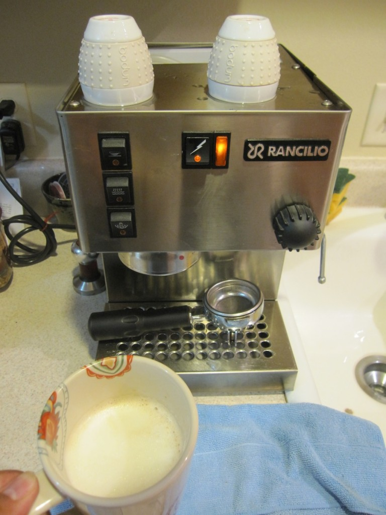 Photo of a latte and a Rancilio Silvia